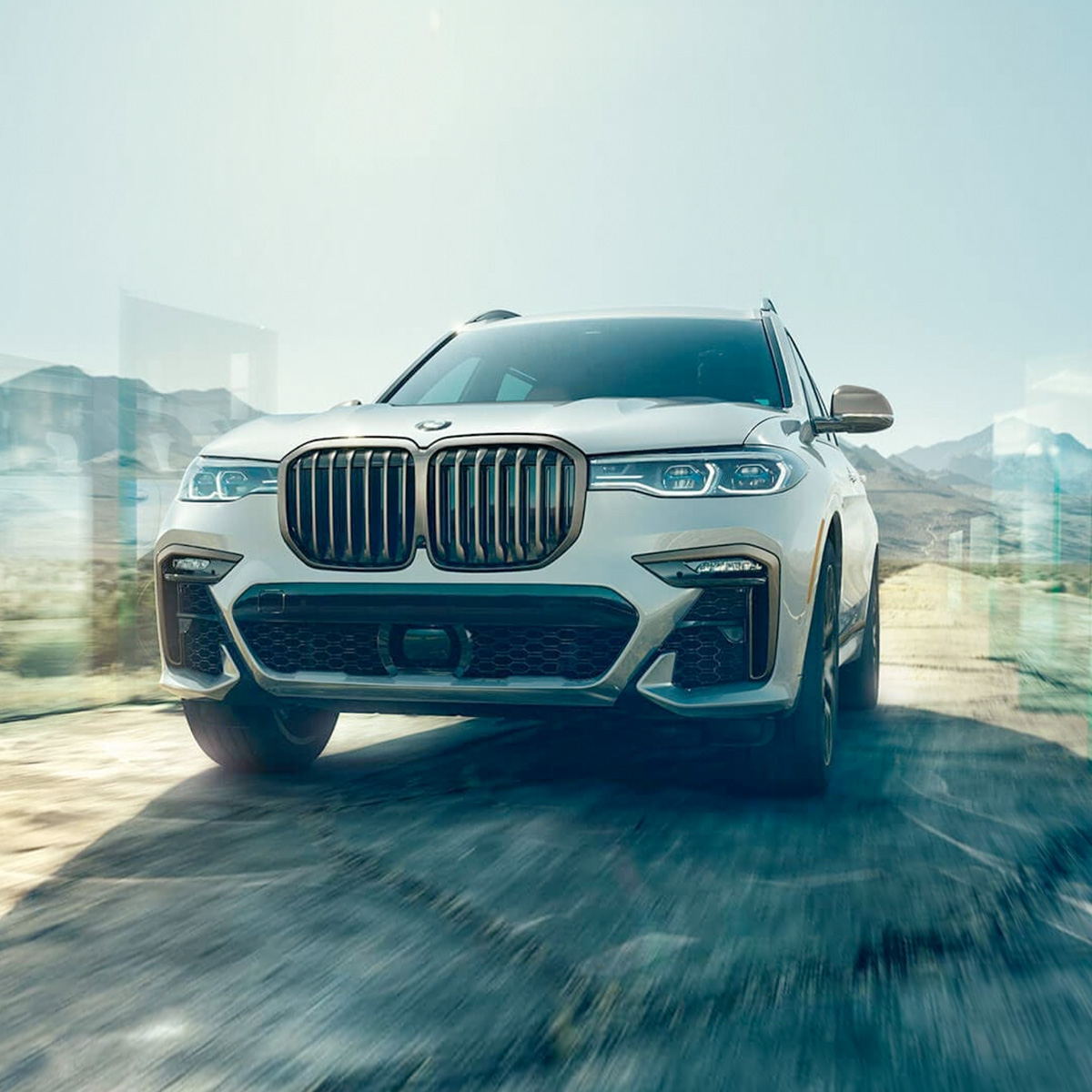 Front view of white 2021 BMW X7 off road